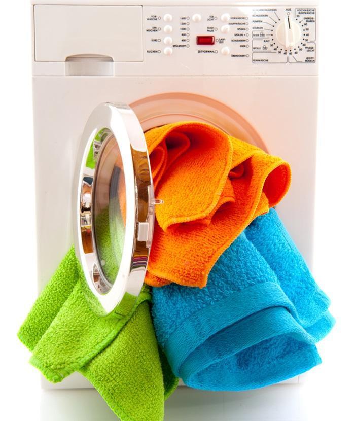 Không nên giặt quần áo quá tải